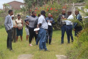 Employees of GKM at the site opposite the Kei Mouth Hall listening to teh mayor Adress them about potential Development on the land